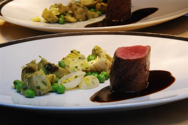 Medallion of Colorado Lamb with Pearl Omions, Artichokes, English Peas, Acai Jus