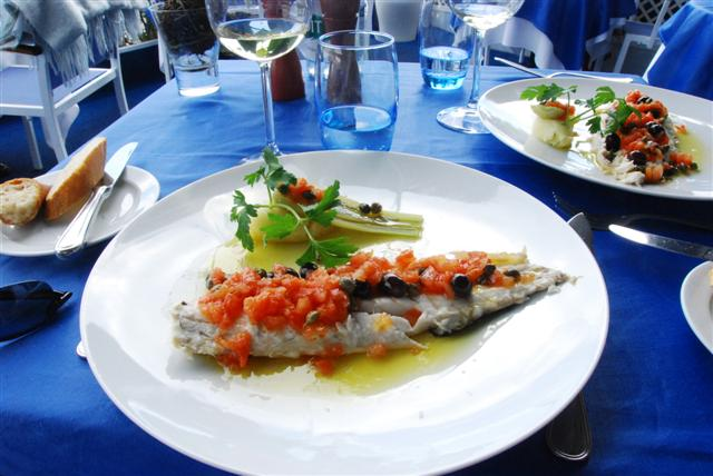 Branzino with fresh tomatoes, olives & olive oil