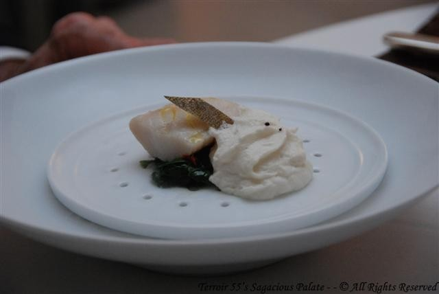 Steamed black cod with spinach, sun dried tomato and whisky foam