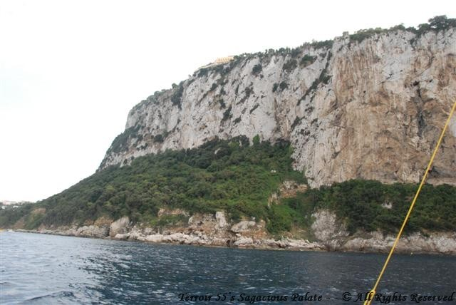 Heading back to the Grand Marina - Caesar Augustus on the cliff above
