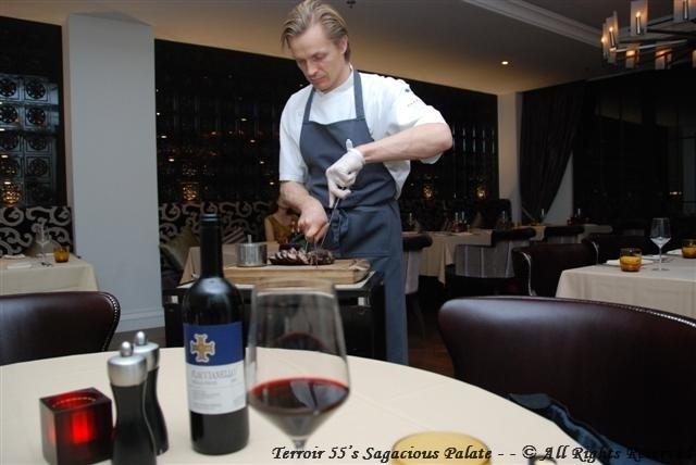 Chef Esko cutting Rotisserie Lamb
