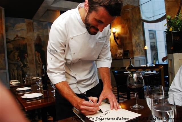 Chef Marchino signing the menu