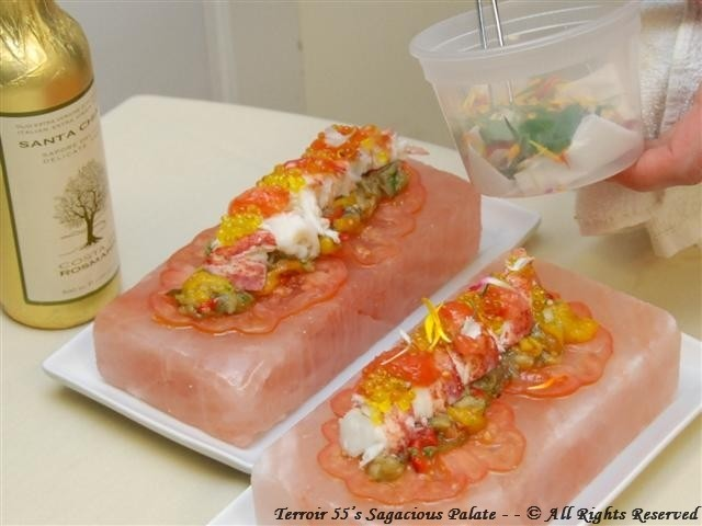 Lobster over heirloom tomatoes and roasted vegetables (onions, eggplant, red, yellow and green peppers) on a Himalayan salt block, topped with extra virgin olive oil and caviar.