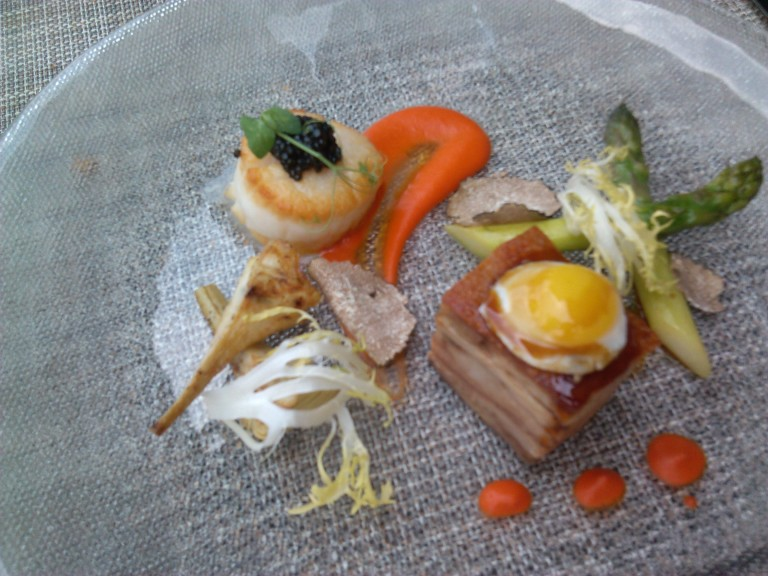 Pork topped with quail egg, scallop topped with caviar, truffles and asparagus