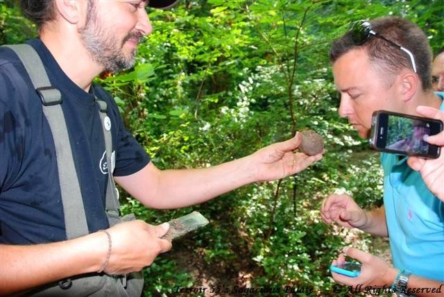 Adam taking a whiff of the fresh pierced truffle