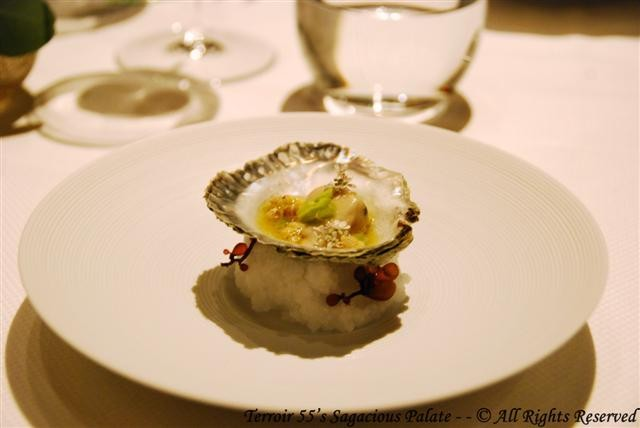 Kushi Oyster served with Passion Fruit and Puffed Buckwheat