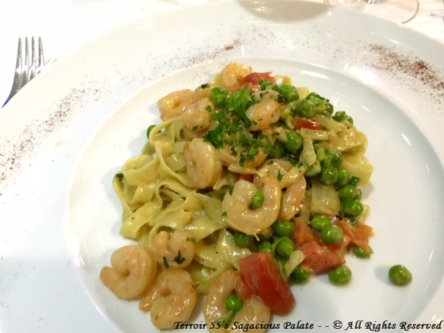 Fettucini Estive – Sautéed baby shrimps in glazed white wine, prepared in a creamy yellow curry sauce, peas, onions and finished with fresh diced tomatoes and fine herbs