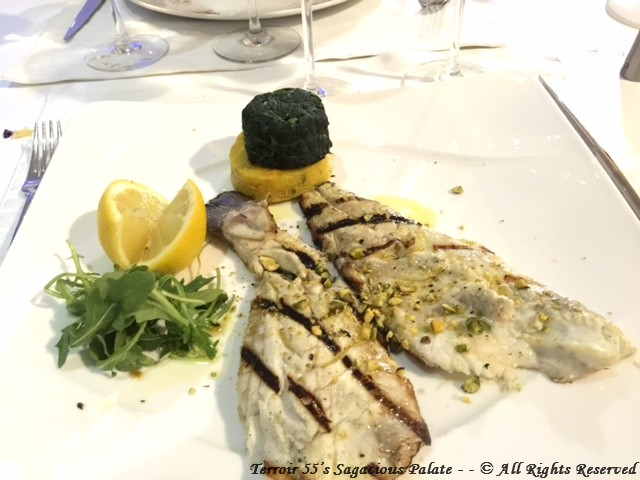 Grilled Branzino - with fresh lemon and herbs. Side of arugula, sauteed spinach and polenta.