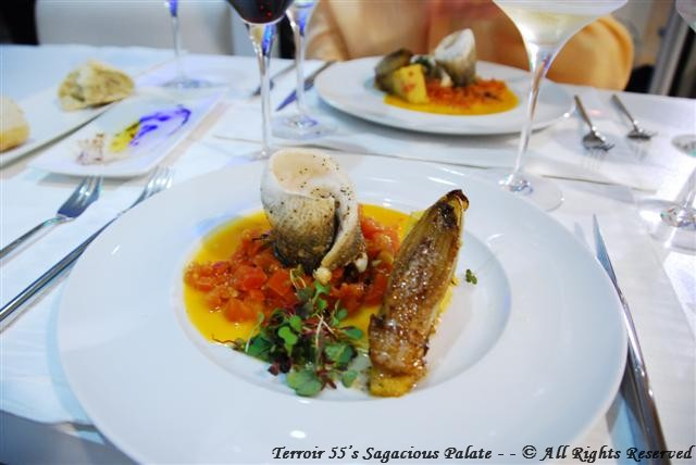 Branzino A L'Aqua Pazza - Branzino filet, steamed in a fresh diced tomato broth, endive and polenta with micro greens