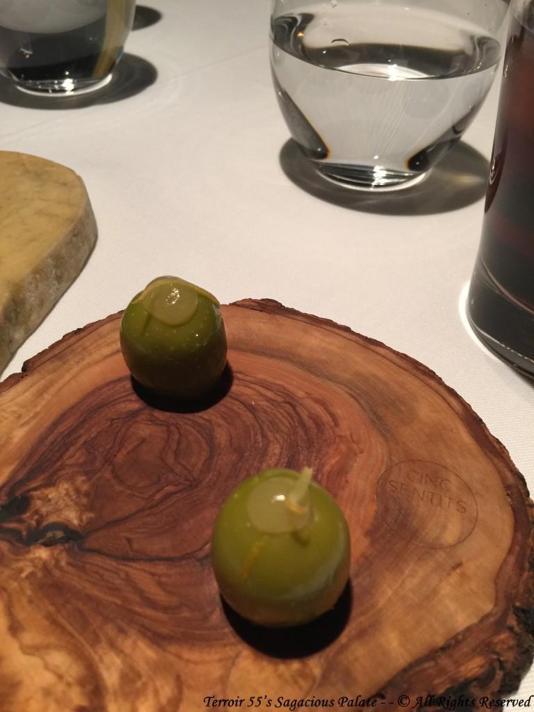 House-marinated gordal olives with olive brine gel and lemon peel