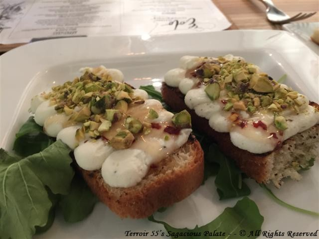 Bruschetta Con Ricotta (Grilled Focaccia topped with Homemade Ricotta, Spicy Pepper infused Honey & Crumbled Pistachios