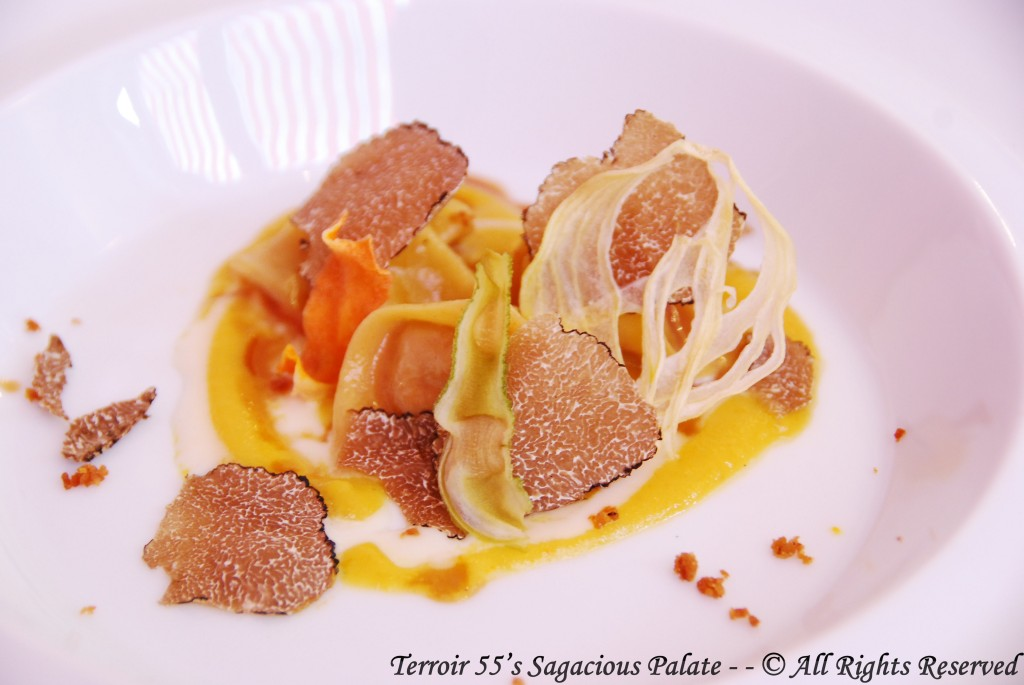 Cappelli filled with overcooked black pork, Amatriciana sauce made with yellow tomato, Parmigiano and black truffle