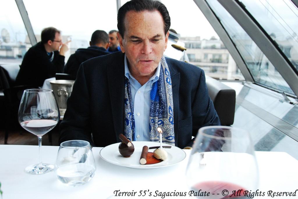 Tony about to enjoy his Dark chocolate in sphere, praline crunchy, milk foam