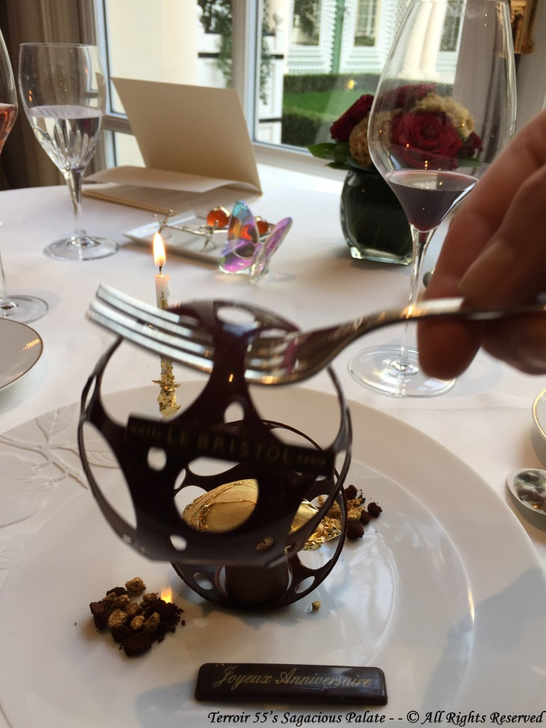 Priceless Nyangbo Chocolate liquid cocoa, Thin tile wafers and gold gilded sorbet.