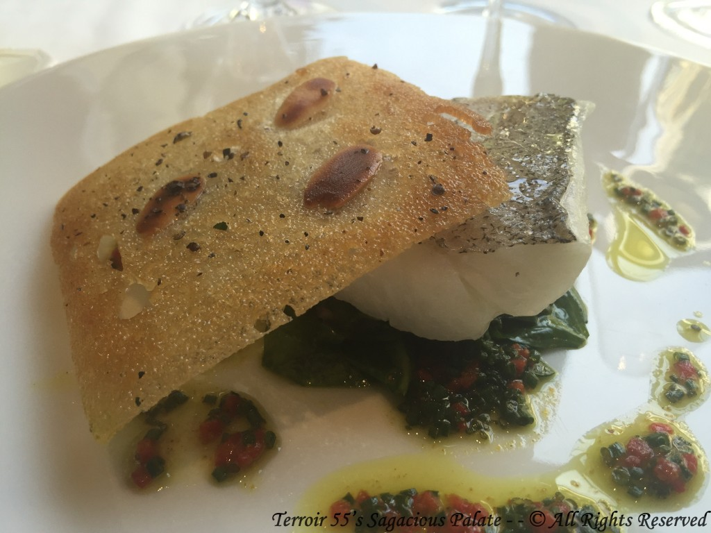 """Line Caught Whiting fish from Saint Gilles Croix-de-Vie In a crust of bread with almonds, """"New-Zealand"""" spinach and olive oil flavored with curry and péquillos pepper."""