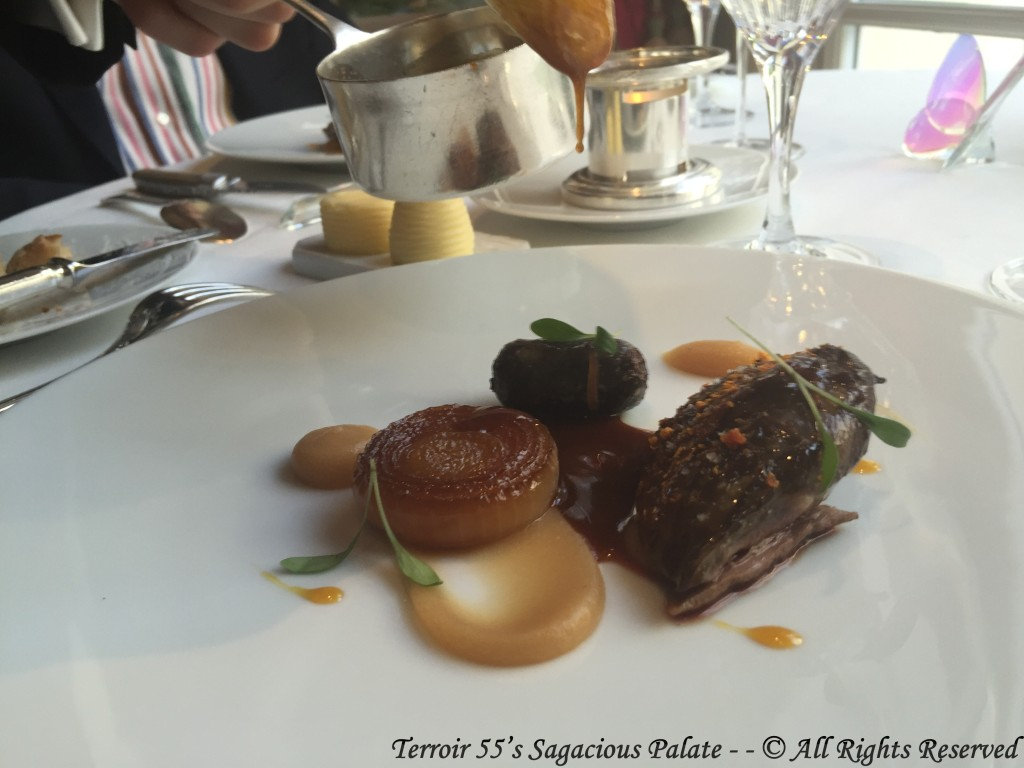 Pigeon from the Bresse area roasted and glazed with orange honey, caramelized onions, black pudding of thighs, baked apple, roasted juice.